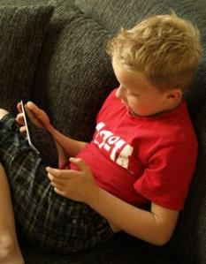 Kid on iPad (c) Twindesign | Dreamstime.com