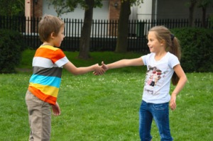 Kids Shake Hands © Andromantic | Dreamstime.com