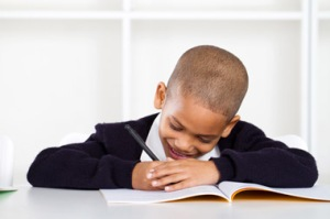 Kid with workbook: (c) Michaeljung | Dreamstime.com
