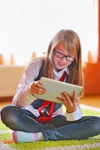 © Jordache | Dreamstime.com girl with ipad