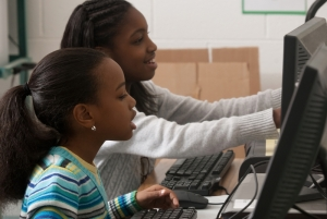two-girls-in-computer-lab-c-isaiahlove-dreamstime-com.jpg